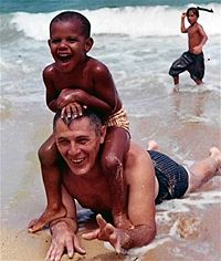 Barack Obama at the age of approximately four years old with his  grandfather Stanley Dunham in 1965 or 1966. The photo was probably taken taken in Hawaii before Barack Obama moved to Indonesia to live with his mother Stanley Ann Dunham and her second husband Lolo Soetoro. Photo:  Unknown